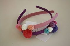 headbands with pompons in crochet but could easily be regular pompoms.