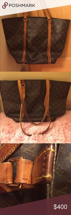 💯% Authentic Vintage Louis Vuitton Monogram SAC 💯% Authentic Vintage Louis Vuitton Monogram SAC Travel Bag EXTRA LARGE. All my items listed are all Authentic. There's some signs of used due to age. No holes. Lots of room to put your personal stuffs. Perfect for busy women that's always on the go. The straps have tiny cracks on the Leather as expected for a Vintage bag. Still in good condition. Date Code: N08964. Made in France. This is actually a great deal of a price. Rare design. Louis…