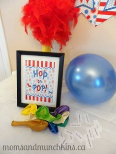 """Free printable Dr. Seuss """"Hop on Pop"""" charades game. Maybe a relay where they have to sit on the balloon to pop it could be fun??"""