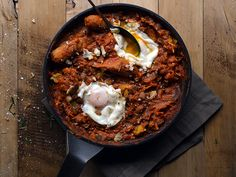 Chorizo and Leek Cassoulet with Poached Eggs from Our Kitchen at Fisher & Paykel. This recipe replaces the deep-dish with a skillet, allowing you to crack an egg into the mix and eat straight out of the pan.  For near instant gratification, make the cassoulet the night before and just bang it into a pan with the eggs when the lunch bell rings.