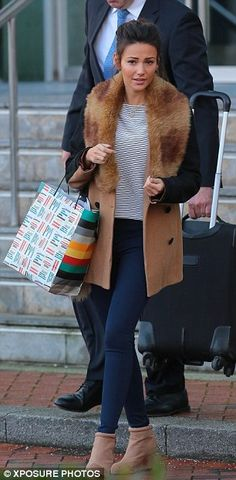 Heading home: Michelle was then seen leaving her Manchester hotel on Saturday morning wear. Cold Weather Outfits, Winter Outfits, Casual Outfits, Michelle Keegan Style, Black Thigh High Boots, Fur Collar Coat, Pinterest Fashion, Fall Looks, Slim Legs