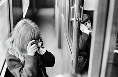 Astrid Kirchherr taking a picture of the Beatles on the train during the filming of A Hard Day's Night, 1964. Photo by David Hurn