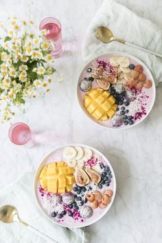 smoothie bowls topped with fresh fruit