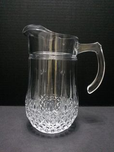 Cristal D'Arques Durand France Longchamp Pitcher 52oz Clear Glass Elegant Design #CristalDArques ..... Visit all of our online locations ..... (www.stores.eBay.com/variety-on-a-budget) ..... (www.amazon.com/shops/Variety-on-a-Budget) ..... (www.etsy.com/shop/VarietyonaBudget) ..... (www.bonanza.com/booths/VarietyonaBudget ) .....(www.facebook.com/VarietyonaBudgetOnlineShopping)