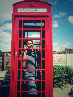 A Viking's fan chatting on the phone in the red phone booth | #VikingsInUK