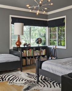 I love grey as a neutral and like the bookshelves below the window - every kid needs a library! {via Houzz Kids}