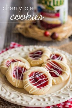 Cherry Pie Cookies at http://therecipecritic.com  Amazing butter cookie thumbprint cookies with delicious #luckyleaf pie filling in the center creating the perfect holiday cookie!