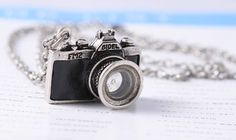 Camera Necklace.  Black and silver metal camera necklace designed for photographers.