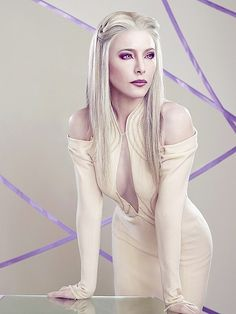 Stahma on Defiance. Creepy and looney tunes, but her lavender eyes and wardrobe are too awesome!