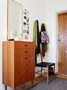retro entryway/ modern/ fifties/ dresser at entryway/ tall mirror/ seating
