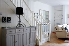 Rehab Diary, Part A Small House Overhaul in London, the Big Reveal - Remodelista Victorian Terrace House, Victorian Homes, Staircase In Living Room, Borrowed Light, Pine Cabinets, Thing 1, Pine Floors, Living Room Kitchen, Stairs Kitchen