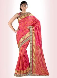 Paint the party scene with a splash of colors by wearing this shaded silk designer saree. It's featuring kasab work, mirror work, moti work and stone work all over that lends it beauty....