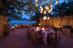 Boma dinner under a classic African chandelier at Busanga Bush Camp, Kafue National Park, Zambia