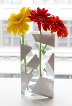 painted vase - I could do this, painters tape, and an assortment of colors!