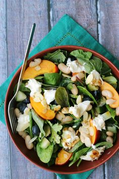 Eat the rainbow with this berry-filled blueberry, nectarine, and burrata salad with maple balsamic vinaigrette.