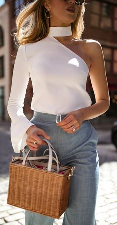Three Spring Staples You Didn't Know You Needed // high-waisted light  chambray wide leg pants, white one-shoulder long sleeve top, square straw  shoulder bag ...