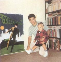 Bruce Lee and sonBrandon along side of a Green Hornet poster
