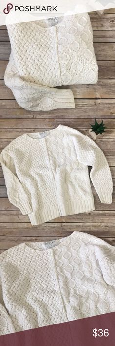 """Hand Knit for The Limited Chunky Ivory Sweater🌺 Hand Knit for The Limited Chunky Ivory Sweater. Size M.  If you love soft, chunky, cable knit & cozy, this is your sweater!  With opposing cable knit pattern on left and right, including sleeves, this adorable style is so unique! A tad oversized for that trendy lounge style or for an extra top underneath! Beautiful shade of ivory.  Cotton/Ramie blend with heavier weight fabric. No stains, tears, pulls, holes noted.  Measures approximately 21""""…"""