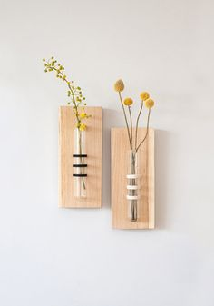 Special tube vase wrapped and sticked to a solid oak board. Pure and simple presence. Perfect for your kitchen, living room and office.