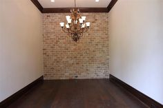 Brick accent wall- love how worn this one looks. Ive always wanted a brick accent wall.