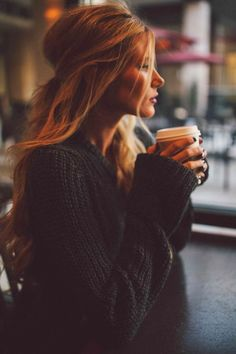 Half up messy hairstyle with Stylish Black Long Sweater and Coffee