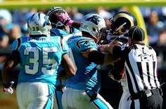 CHARLOTTE, NC - OCTOBER 20: Jordan Gross #69 of the Carolina Panthers and Robert Quinn #94 of the St. Louis Rams push eachother during their game at Bank of America Stadium on October 20, 2013 in Charlotte, North Carolina. (Photo by Streeter Lecka/Getty Images)