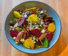 The duck confit salad comes with roasted beets, toasted pumpkin seeds, blue cheese, and persimmon vinaigrette.