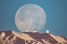 """This is a single exposure. There was no compositing. It was shot from 30 miles away with a 1600mm equivalent focal length. I don't Photoshop in moons, they are all 100% natural, organic, and gluten-free"" - Moonset over Mauna Kea, Hawaii"