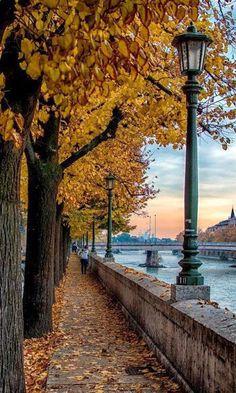 Walking along the Adige in the fall. .. Verona, Italy