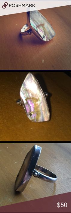 Sterling silver Abalone opalescent artisan ring 6 MAKE AN OFFER ❤️ Beautiful Abalone ring set in sterling silver (band marked 925). I bought it at an antique store but I have no idea what era it is from. It looks to be handmade by a skilled jeweler. My finger is a size 6 and it fits me well. The top is simply stunning and it never fails to capture the light. The underside contains what appears to be some kind of darker jewelers adhesive (does not show on the other side). Nonsmoking home…