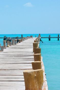 Pier off the beach over a turquoise blue ocean ...#vacation #travel
