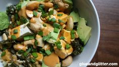 1 5.5 ounce can coconut milk, approximately 1 tablespoon curry paste, 1/2″ piece fresh ginger, coarsely chopped 1 clove fresh garlic, coarsely chopped 1/2 teaspoon brown sugar (optional) 1 teaspoon soy sauce (optional) chopped avocado, green onions, and roasted cashews for toppings (optional)