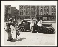 Photographer Zack Brown shooting dapper men in Harlem, c. 1937 by Eliot Elifoson, Collection of the Smithsonian National Museum of African American History and Culture