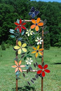 Items similar to Large Stained glass Plant Stake Garden Decor Flowers Butterfly Leaves Suncatcher on Etsy - This listing is for a beautiful one of a kind garden stake designed and created by me. Stained Glass Ornaments, Stained Glass Flowers, Stained Glass Suncatchers, Stained Glass Designs, Stained Glass Panels, Stained Glass Projects, Fused Glass Art, Stained Glass Patterns, Stained Glass Art