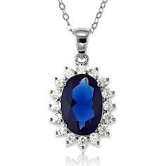 Complete your princess-inspired look with this stunning white CZ and royal blue stud necklace. The white cubic zirconia accents the sapphire stone beautifully. This elegant yet playful accessory will