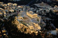 """The Parthenon is located on a hill known as the Acropolis, or """"High City."""" Archaeologists found that during the 2nd millenium the Acropolis had been the site of a Mycenaean citadel. Athenian myths associated the Acropolis also as the site of the competition between Athena and Poseidon for hegemony over Athens. Athenians legends also associate the Acropolis with the founding of the city.[Add reference to Erechtonius] During the Archaic period major temples were constructed on the Acropolis."""