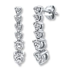 de06e2a05 Classic and delicate, these dangle earrings feature six round diamonds.  Diamond Bracelets, Bangle