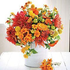 fall flowers. Lovin the giant bucket idea!