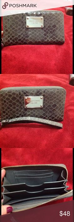 """MK snake leather wristlet in silver. Michael Kors Silver Python embossed genuine leather phone zip-around wristlet. Bought@Michael Kors store-used only once! Approx measurements 6.25""""L x 3.5""""H x. Perfect condition. MICHAEL Michael Kors Bags Clutches & Wristlets"""