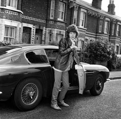 Mick Jagger stepping out of his Aston Martin in Milman Road, Reading in 1967 to visit his girlfriend at the time Marianne Faithfull.