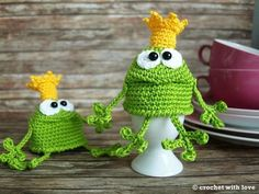 Crochet egg cosies, green frog prince.