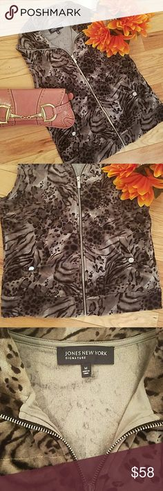Jones New York vest Darling NWOT black and grey vest! Cotton polyester blend feels like velour! Cute side pockets for your phone and keys plus.. So chic over a sweater with jeans or black pants! So soft you can wear it alone! Jones New York Jackets & Coats Vests