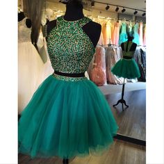 Short two-piece Sherri Hill dress. Green, short dress with beaded top. Homecoming dress. Short dress for a wedding or evening out.