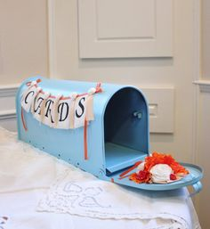 Tiffany blue and orange card box/mail box. Clever!
