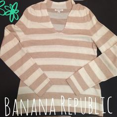 "✂️BOGO✂️Banana Republic Sweater Tan and Cream Banana Republic V-Neck Sweater. When you want that preppy look this is the perfect sweater for you. Throw on a pair of jeans & brown boots your ready for anything the day might bring you. Has ruching along the shoulders to give it an up-dated look. Has a small stain on the right sleeve priced accordingly & pictured in photo #2. Hand Wash 3% Cashmere 45% Nylon 23% Wool 27"" long 19"" from pit to pit Banana Republic Sweaters V-Necks"
