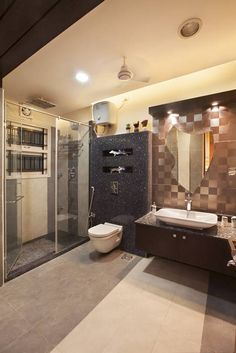 Spacious son's toilet finished with metallic tiles and rich granite.