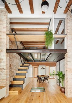 Crumbling brick surfaces hint at the rich past of this triplex apartment in Barcelona, designed by architect Valentí Albareda with arch-shaped openings and warm oak floors. Contemporary Architecture, Interior Architecture, Contemporary Design, Modern Design, Barcelona Apartment, Exposed Brick Walls, Apartment Interior, Interior Design Inspiration, Design Ideas