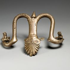 Handles and feet of a bronze louterion (basin), Archaic, 1st quarter of the 5th century BC, Greek, bronze