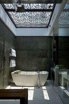 Freestanding bath, open shower, and creative skylight treatment.