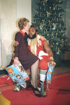 Mr. T dressed as Santa at the White House with First Lady Nancy Reagan on his lap 1983. http://ift.tt/2kuA43v